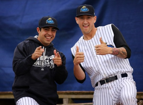 Trenton Thunder pitcher Daniel Camarena (left) welcomes 26 year-old right handed reliever David Kubiak into the bullpen before a game against the Harrisburg Senators at ARM & HAMMER Park in Trenton on Saturday, May 7, 2016. Photo by Martin Griff
